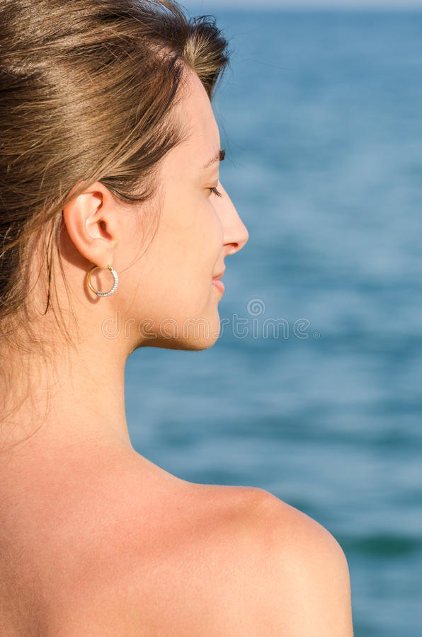 Beautiful Young Girl Enjoys The Ocean Breeze stock photography