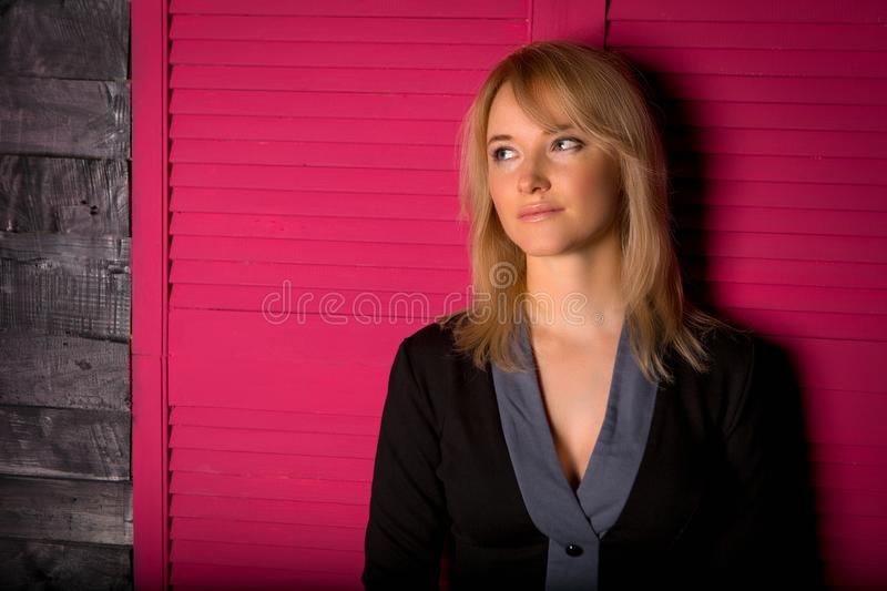 Beautiful young girl in a business suit royalty free stock image