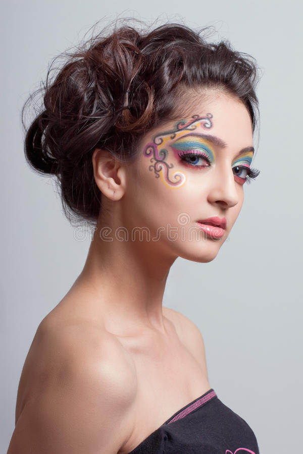 Beautiful young girl with fantasy makeup royalty free stock images