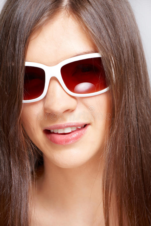 Beautiful young girl with fashion sunglasses stock photos