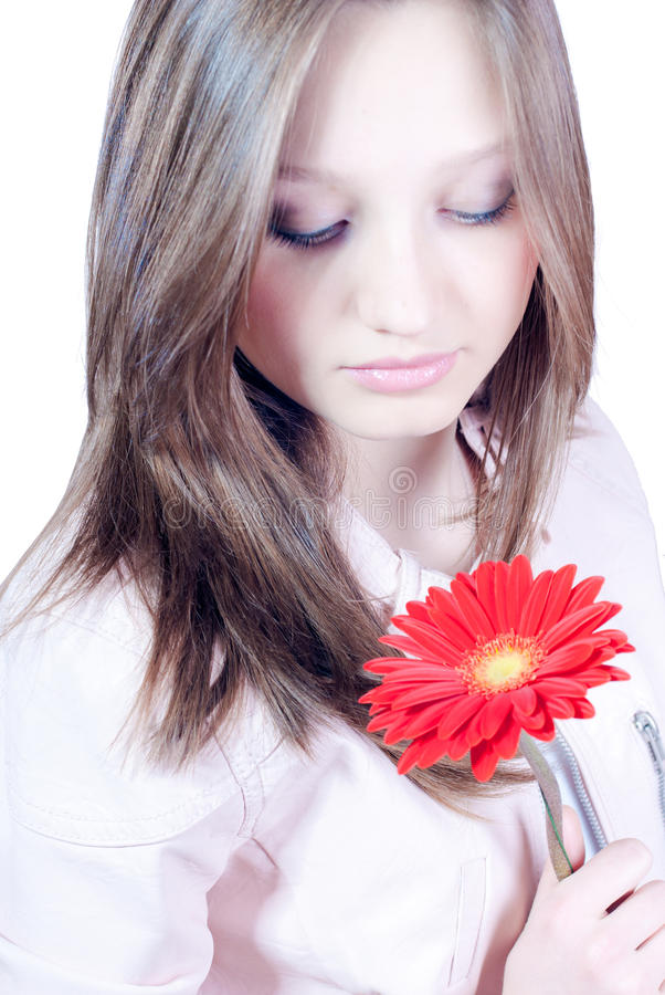 Download Beautiful Young Girl With Flower Isolated Stock Photo - Image of female, excited: 23875926