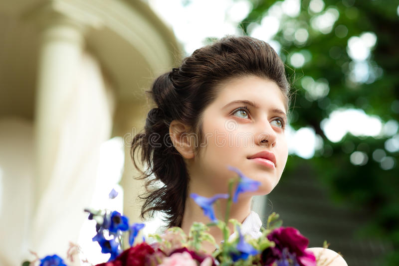 Beautiful young girl with flowers royalty free stock photo