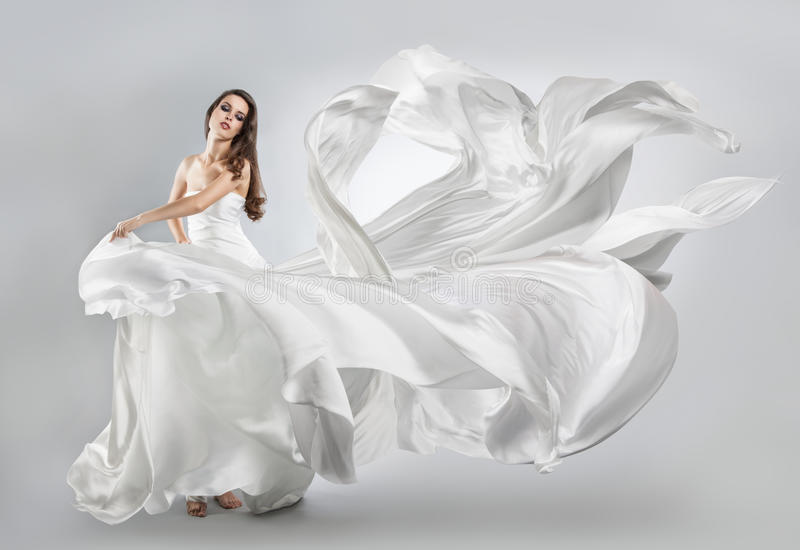 Beautiful young girl in flying white dress. royalty free stock photo