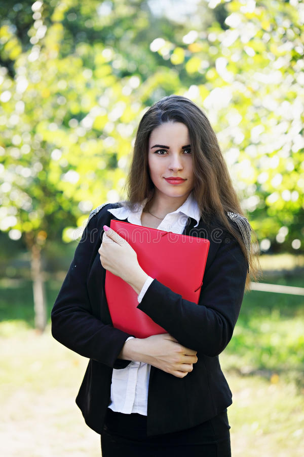 Beautiful young girl with folder stock images
