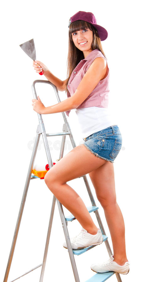 Beautiful young girl is going to do repair stock photography