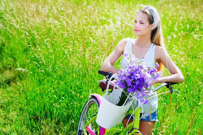 Beautiful young girl with her cruiser bike stock photos