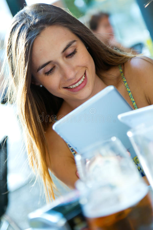 Beautiful young girl with her digital tablet. royalty free stock images