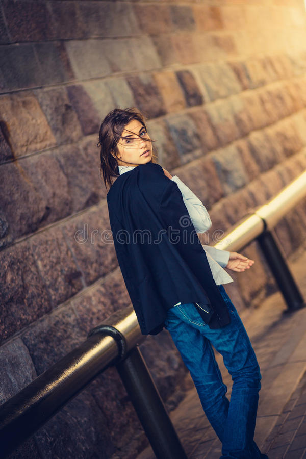 Beautiful young girl hipster goes royalty free stock image