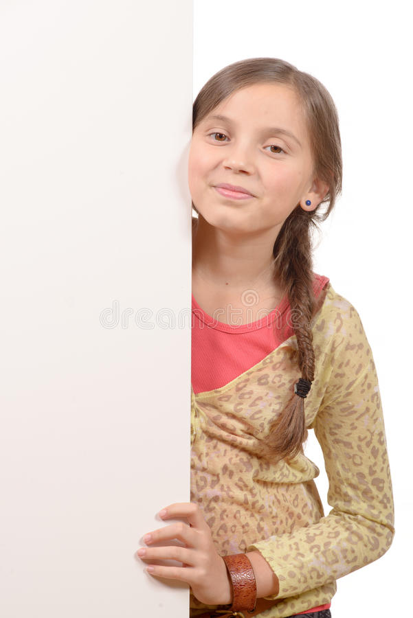 Beautiful young girl holding blank poster isolated. On white stock image