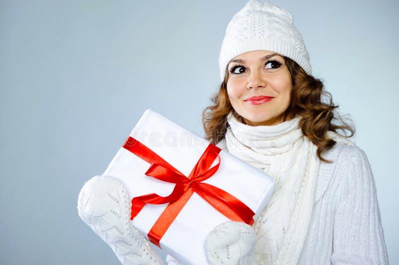Beautiful young girl holding present box stock photos