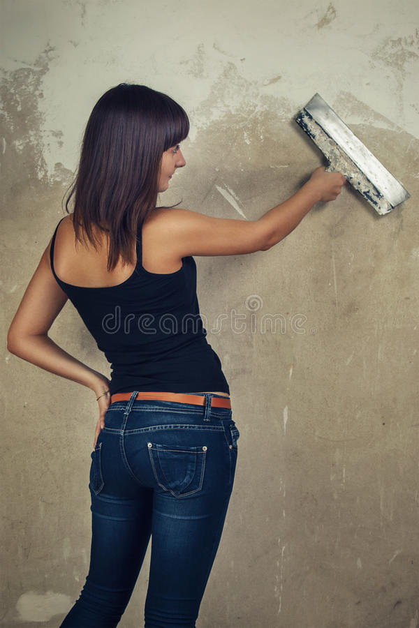 Download Beautiful Young Girl Holding Spatula Over Grunge Stock Image - Image of construction, tool: 28531721