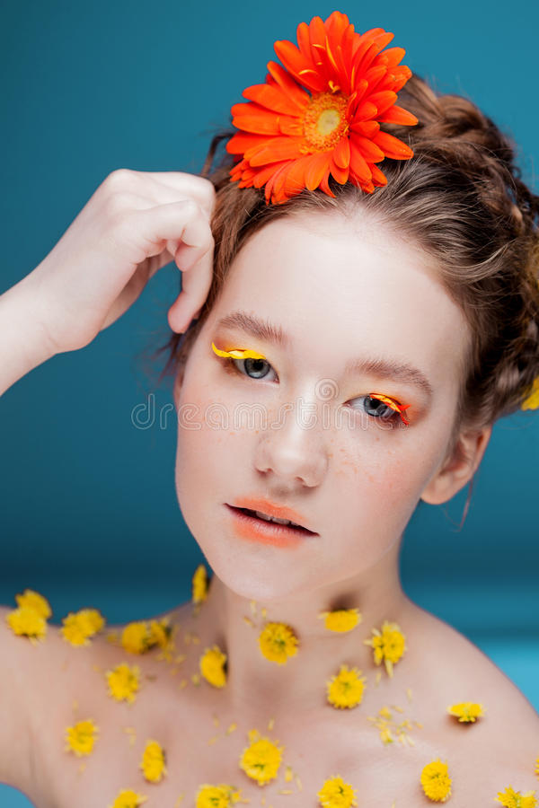 Beautiful young girl in the image of flora, close-up portrait stock image