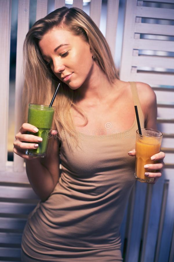 Free Beautiful Young Girl In A Health Cafe Drinking Smoothies. Go Vegetarians. Healthy Life With Nature Products. Stock Photo - 106269830