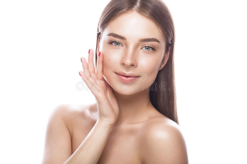 Beautiful young girl with a light natural make-up and perfect skin. Beauty face. royalty free stock images