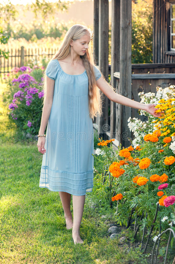 Beautiful young girl with long blond hair stock photography