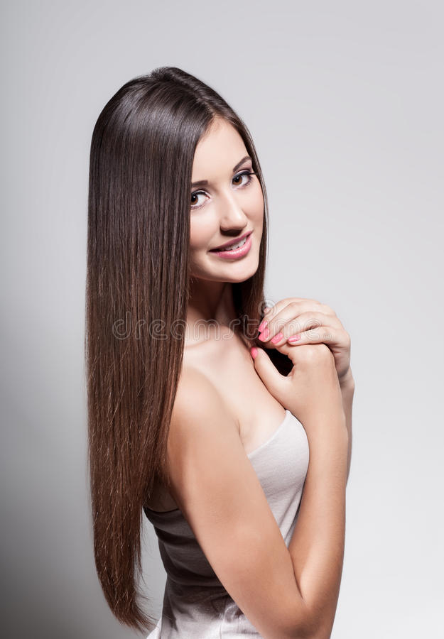 Beautiful young girl with long hair stock images
