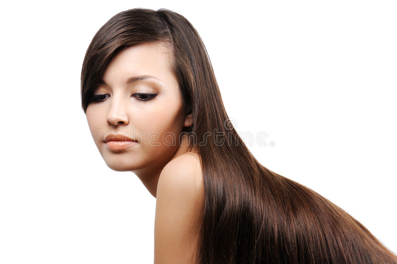 Beautiful young girl with long smooth hairs stock photography