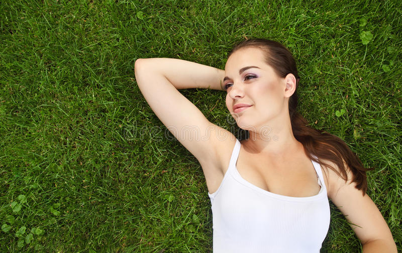 Download Beautiful Young Girl Lying On The Grass Stock Image - Image: 25390147
