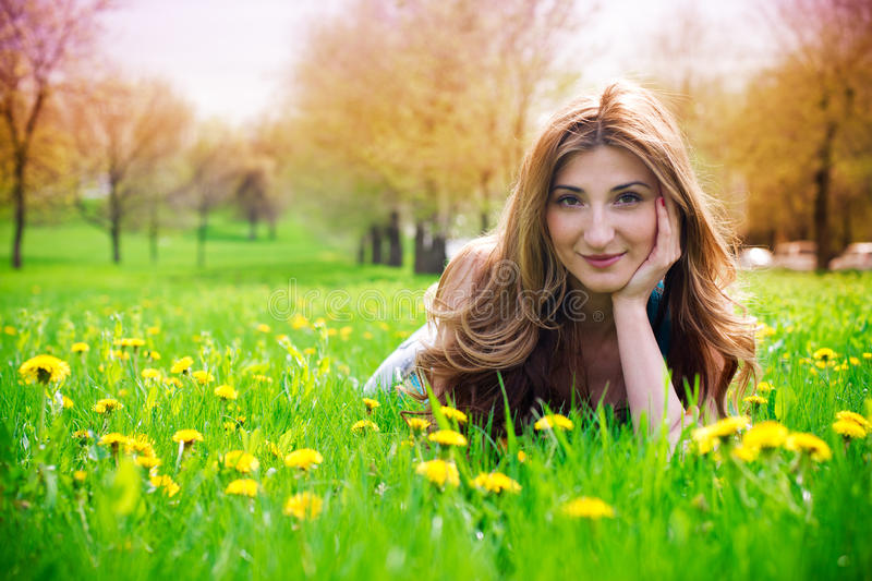 Beautiful young girl in meadow royalty free stock images
