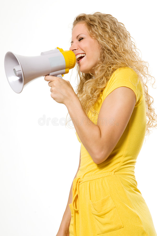Beautiful young girl with megaphone over white. Beautiful shouting young girl with megaphone over white royalty free stock image