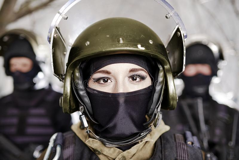 The beautiful young girl in a military uniform and a helmet royalty free stock photo