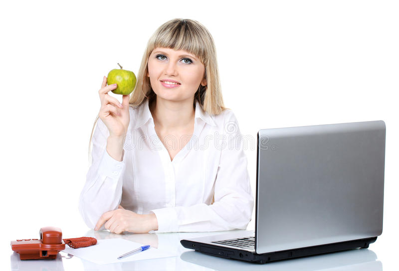 Beautiful young girl in the office stock photos