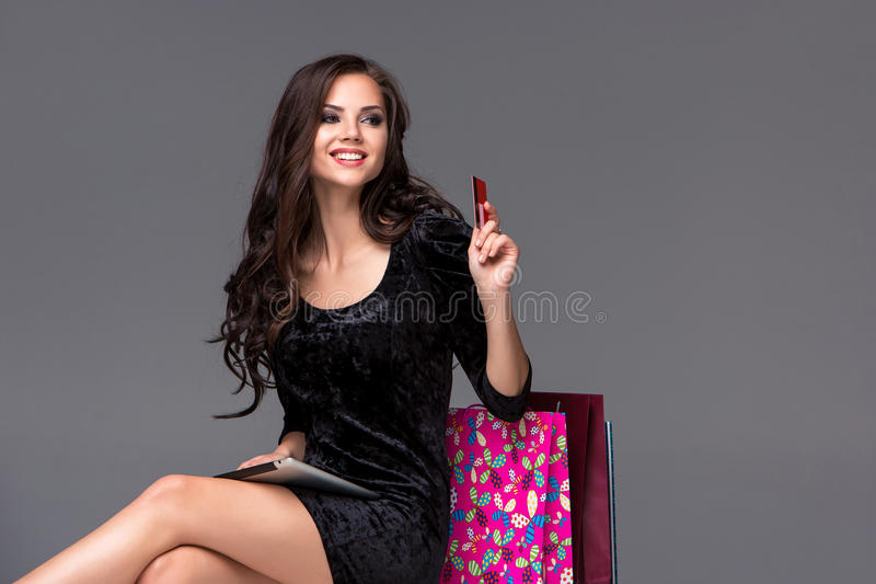 Beautiful young girl paying by credit card for royalty free stock images