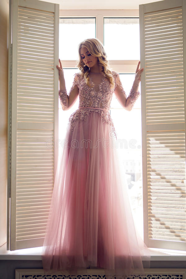 Beautiful young girl in pink lace dress royalty free stock image