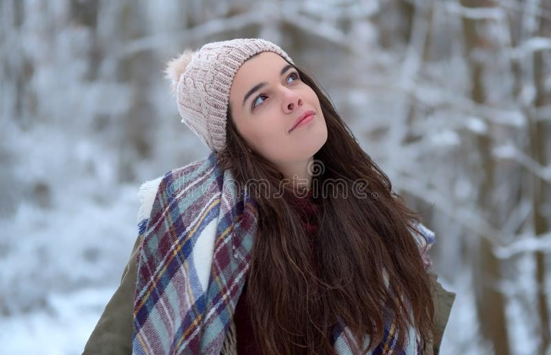 Beautiful young girl portrait with scarf, joyful model cold in winter park. Happy enjoying the nature royalty free stock photography