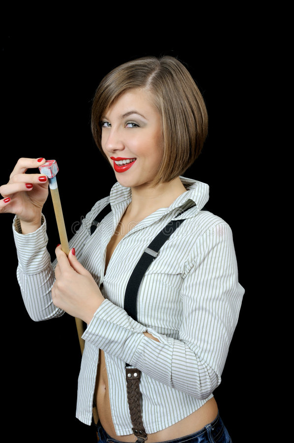 Beautiful Young Girl Prepares Cue To Billiard Royalty Free Stock Photography