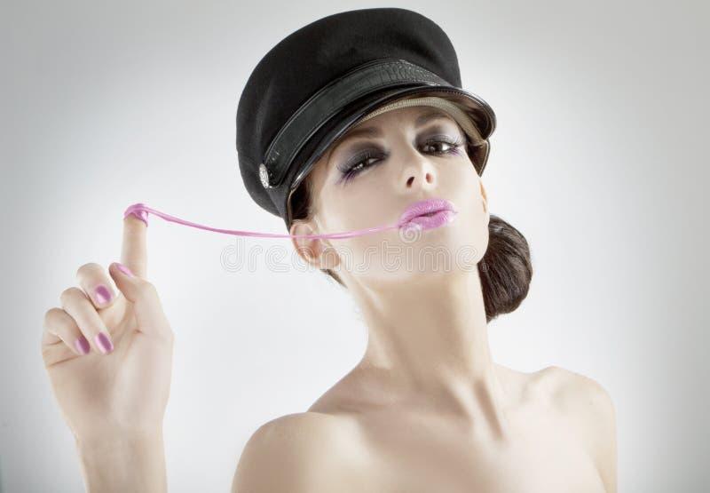 Beautiful young girl pulling bubblegum stock image