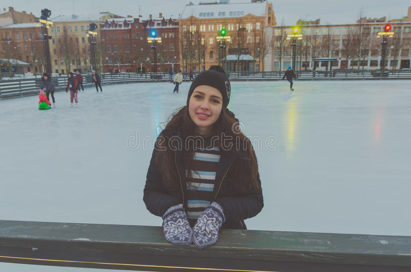 Beautiful young girl at the rink in winter, ice. Beautiful girl at the rink on a winter`s day, alone stock photo