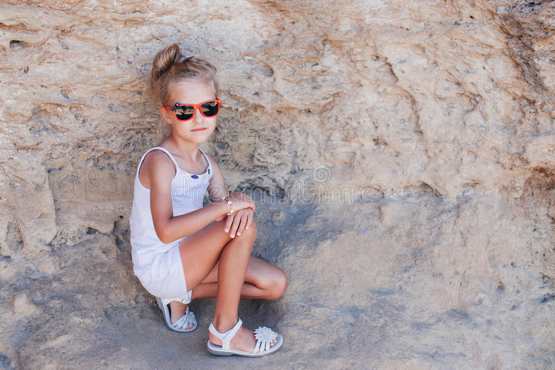 Beautiful young girl in the rocks stock images