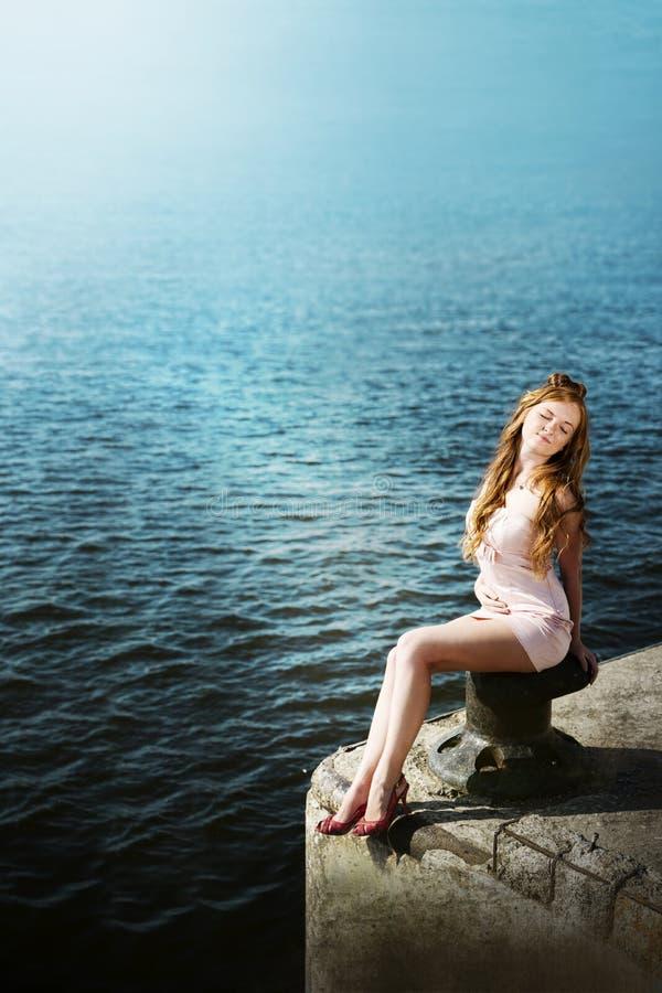 Beautiful young girl on sea stock photography