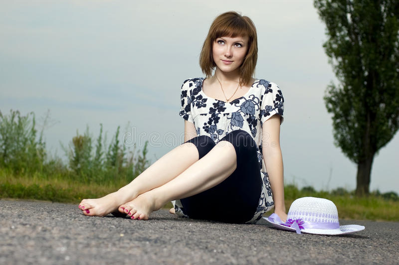 Download Beautiful Young Girl Sits In A Hat Stock Photo - Image: 23934366