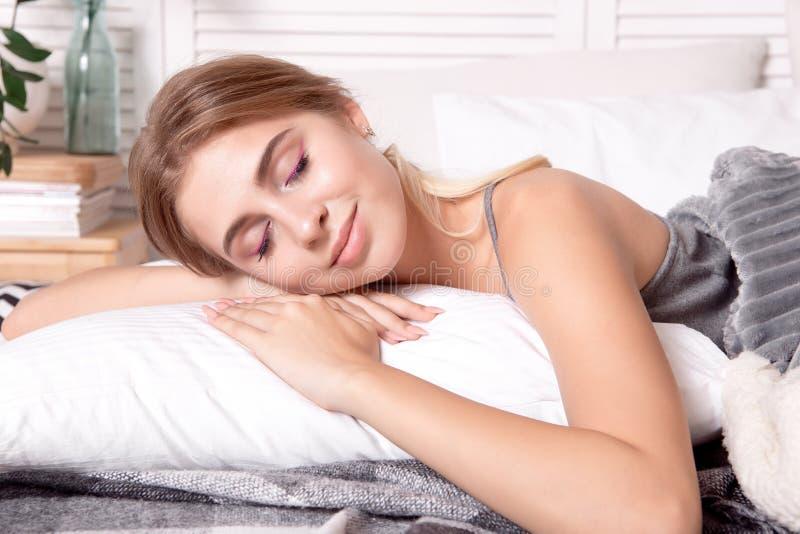 Beautiful young girl sleeping in the bedroom. stock image