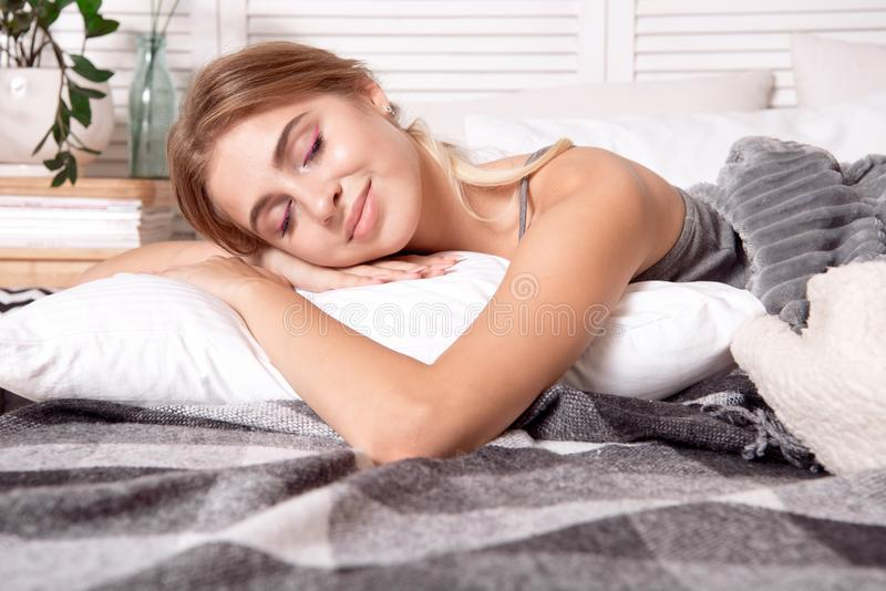 Beautiful young girl sleeping in the bedroom. royalty free stock images