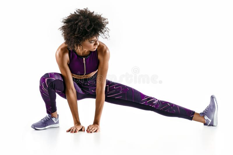 Beautiful young girl stretching her hamstrings. stock image