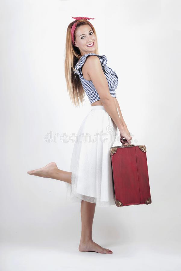 Beautiful young girl with suitcase stock photography