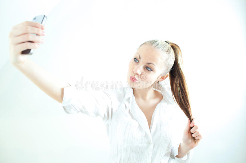 Beautiful young girl taking selfie royalty free stock photo