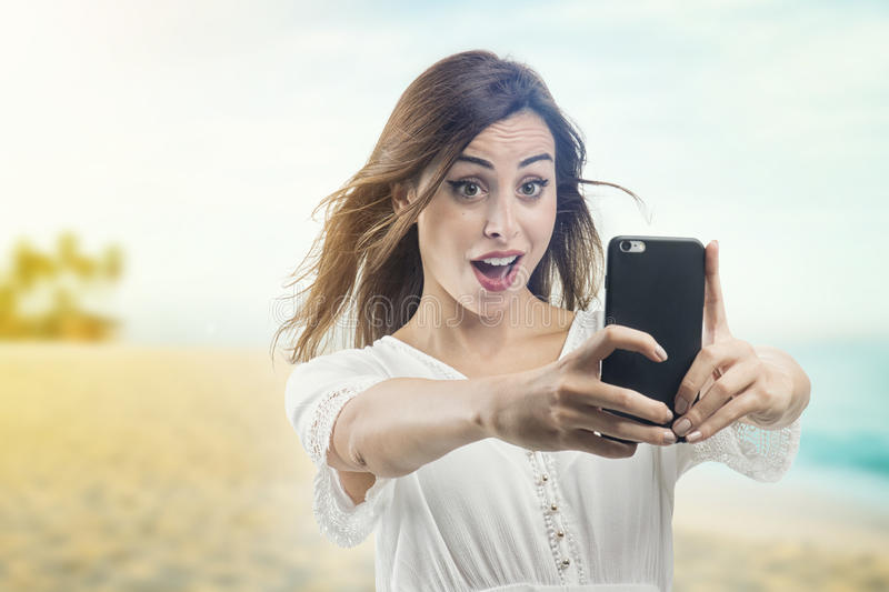 Beautiful young girl taking a selfie. Beautiful woman taking picture of herself, selfie . Pretty mixed race woman taking a selfie, Beautiful young girl taking a royalty free stock image