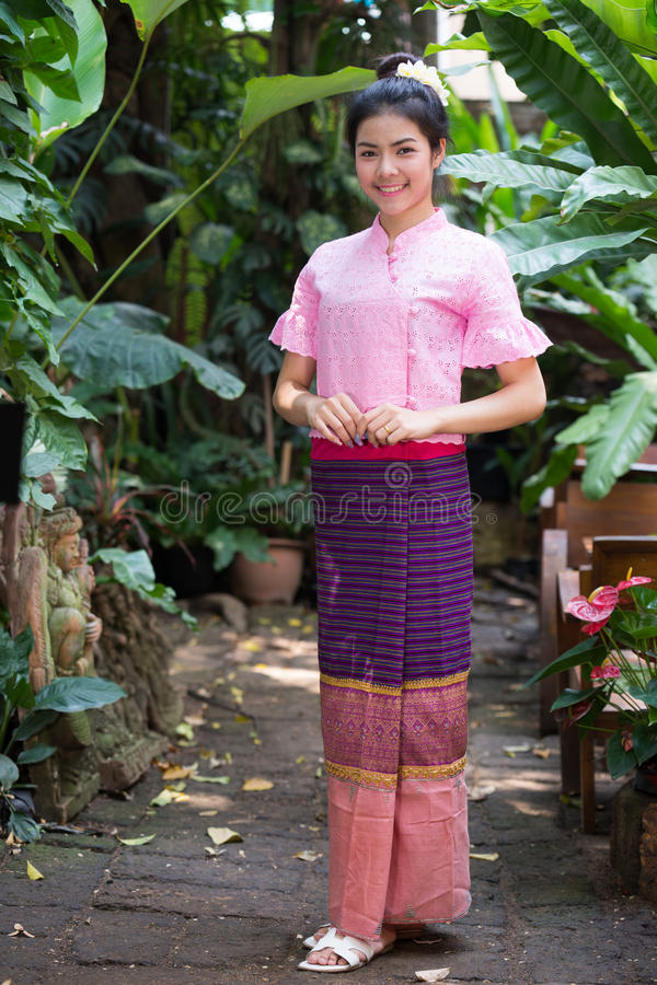 Beautiful young girl with thai traditional dress portrait. Beautiful young girl with thai traditional portrait outdoor jungle background royalty free stock images