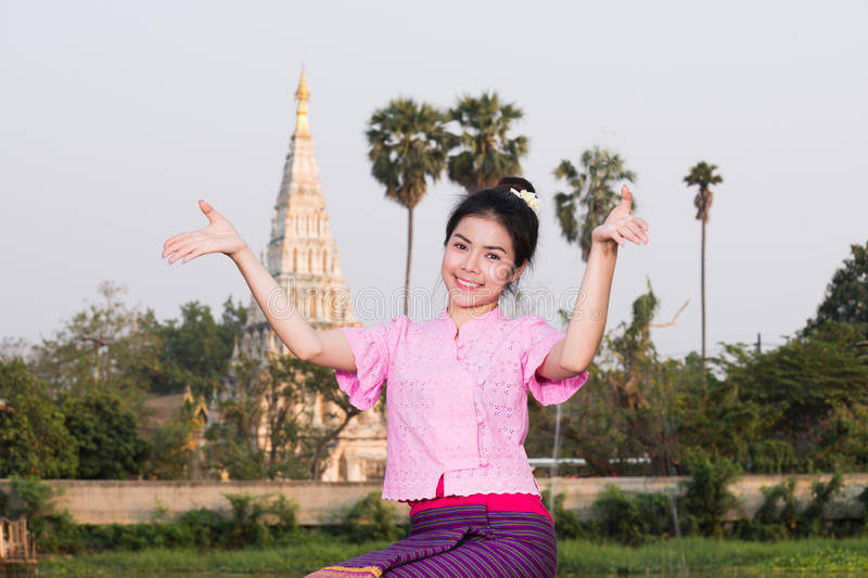 Beautiful young girl with thai traditional dress welcome dance stock photography