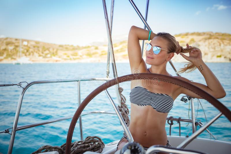 Beautiful girl on sail boat royalty free stock photo