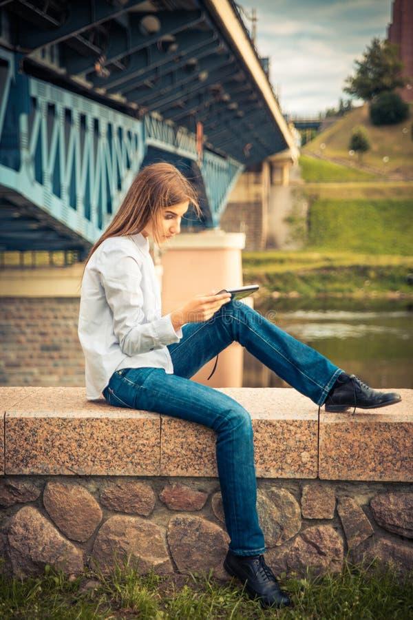 Beautiful young girl using digital tablet