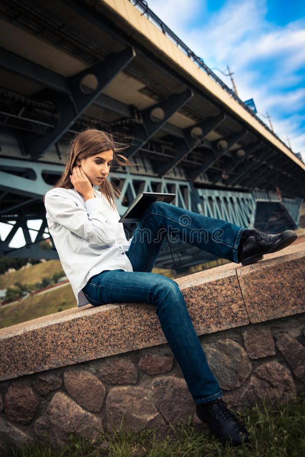 Download Beautiful Young Girl Using Digital Tablet Stock Photo - Image: 32091852
