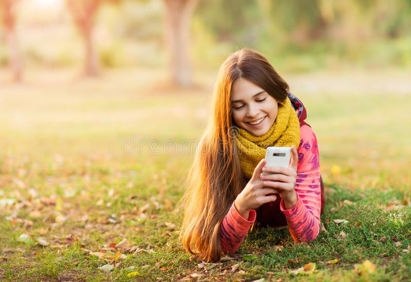 Portrait of a happy girl smilling to the mobile camera royalty free stock photography