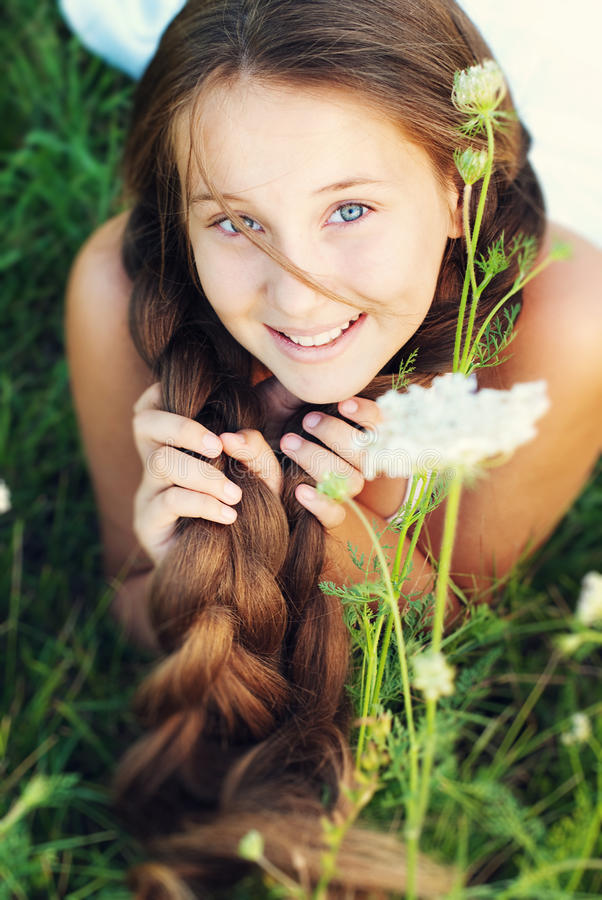 Beautiful Young Girl with very Long Hair Outdoors. stock photos