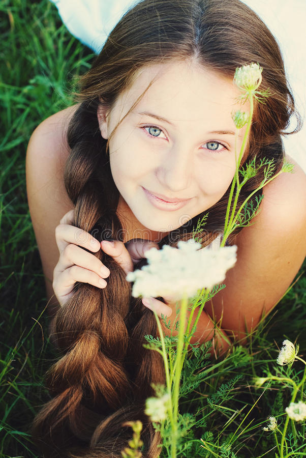 Beautiful Young Girl with very Long Hair Outdoors. royalty free stock image
