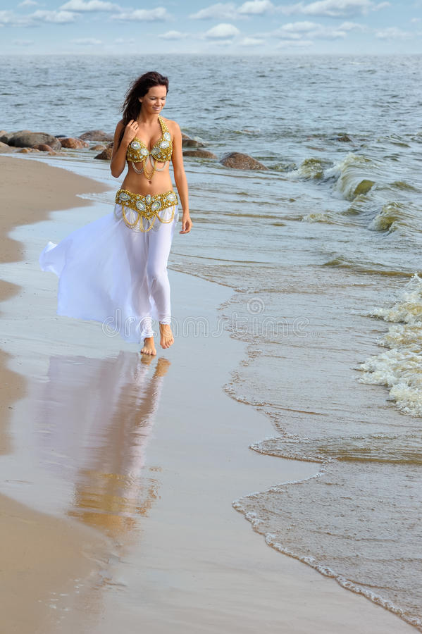Beautiful Young Girl Walking On Beach Royalty Free Stock -8490